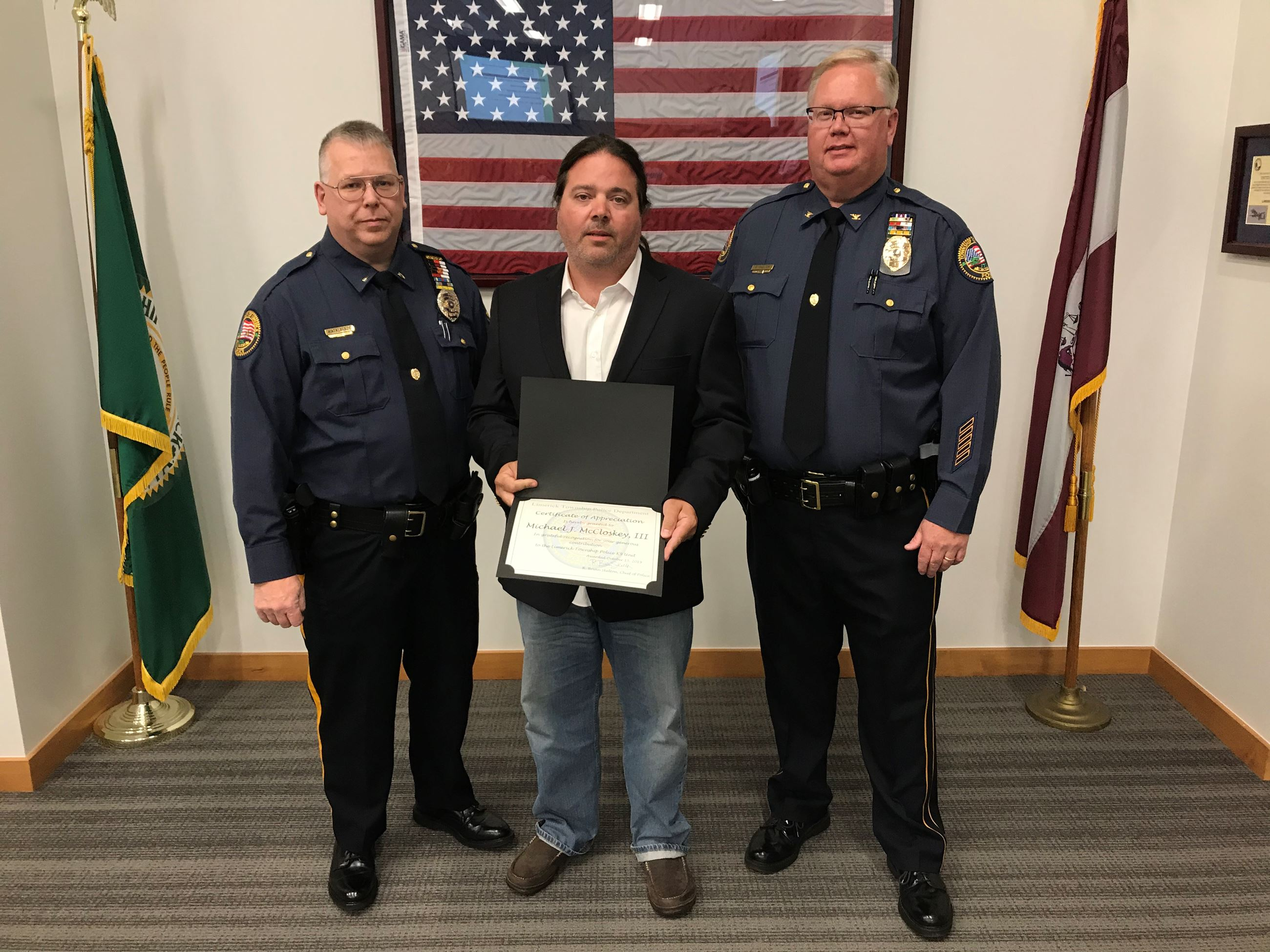 Mike McCloskey Recognized for Donation to Police K-9 Unit - pictured Police Lieutenant Robert Matala